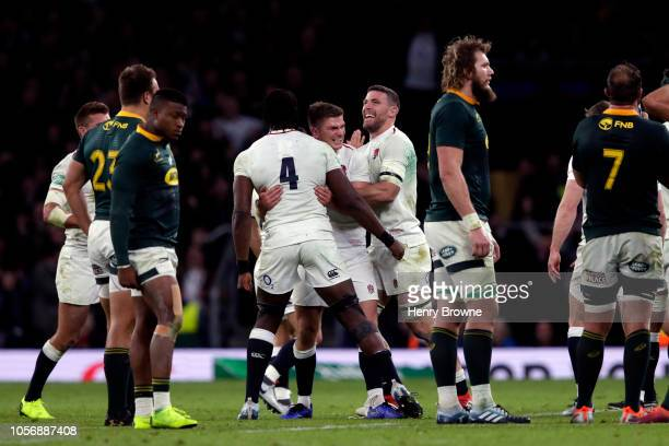 Owen Farrell celebrates with teammates Maro Itoje and Mark Wilson of England following victory in the Quilter International match between England and...