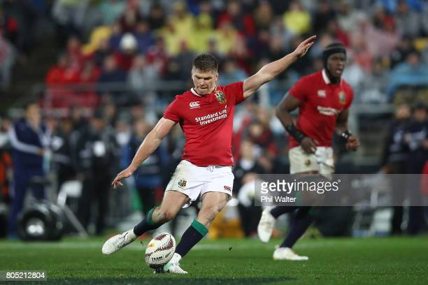 Owen Farrell kicks a penalty to put the Lions ahead during the International Test match between the New Zealand All Blacks and the British Irish...