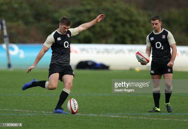 Owen Farrell kicks the ball upfield wathed by George Ford during the England training session held at Pennyhill Park on February 20 2019 in Bagshot...