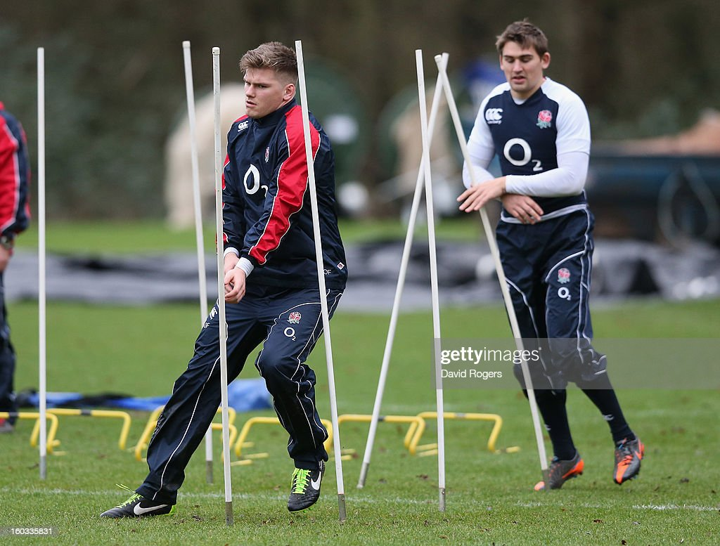 Owen Farrell (L) leads team mate Toby Flood through the slalom poles during the England training session at Pennyhill Park on January 29, 2013 in Bagshot, England.