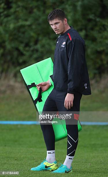Owen Farrell looks on during the Saracens training session held at their training venue on October 12, 2016 in St Albans, England.