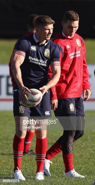 Owen Farrell looks on with team mate George North during the British Irish Lions training session held at Linwood Rugby Club on June 9 2017 in...