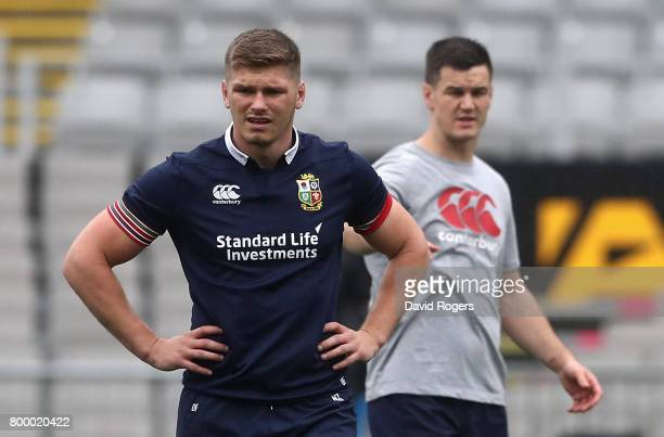 Owen Farrell looks on with team mate Jonathan Sexton kicking session at the Eden Park on June 23 2017 in Auckland New Zealand