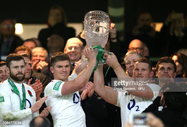 Owen Farrell of England and Dylan Hartley of England lift the Cook Cup during the Quilter International match between England and Australia at...