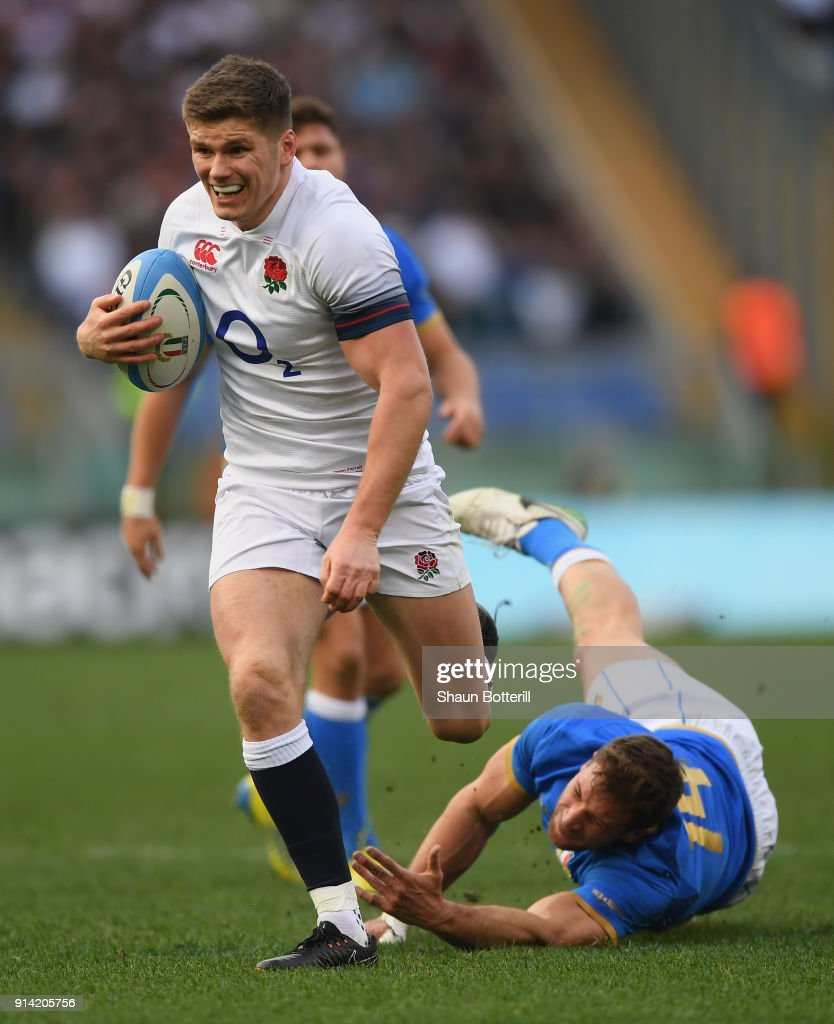 Owen Farrell of England beats the tackle of Tommaso Benvenuti of Italy to break through and score during the NatWest Six Nations match betwwen England and Italy at Stadio Olimpico on February 4, 2018 in Rome, Italy.