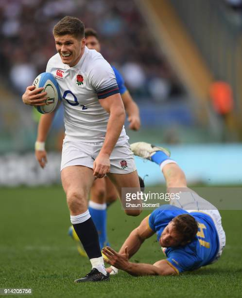 Owen Farrell of England beats the tackle of Tommaso Benvenuti of Italy to break through and score during the NatWest Six Nations match betwwen...