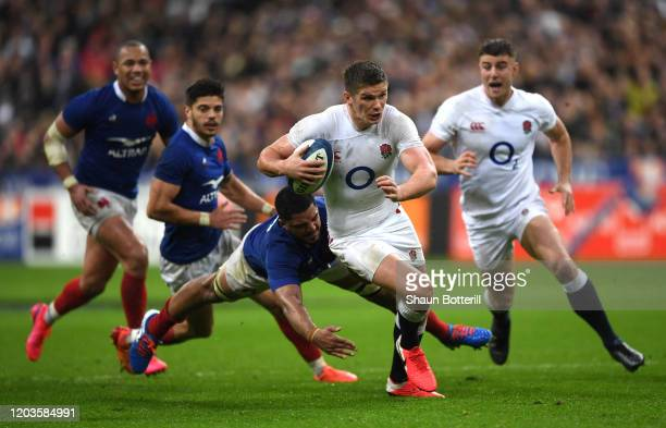 Owen Farrell of England breaks through the tackle of Boris Palu of France during the 2020 Guinness Six Nations match between France and England at...