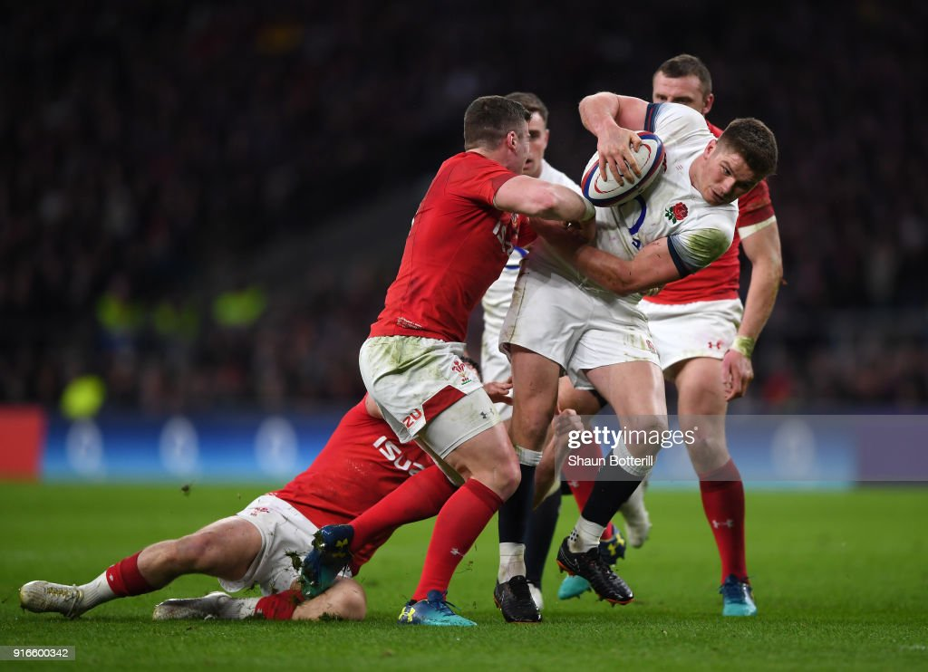 Owen Farrell of England breaks through the Welsh defence during the NatWest Six Nations round two match between England and Wales at Twickenham Stadium on February 10, 2018 in London, England.