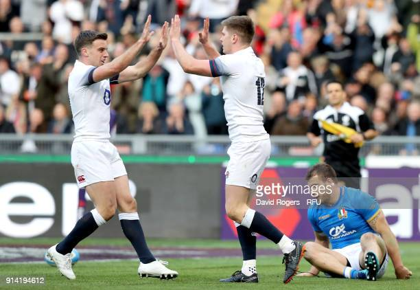 Owen Farrell of England celebrates scoring his sides third try with teammate George Ford during the NatWest Six Nations round One match between Italy...