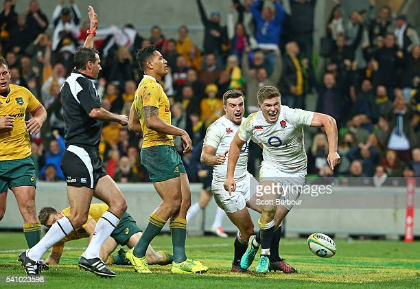 Owen Farrell of England celebrates with George Ford after scoring the winning try as Israel Folau of the Wallabies looks on during the International...