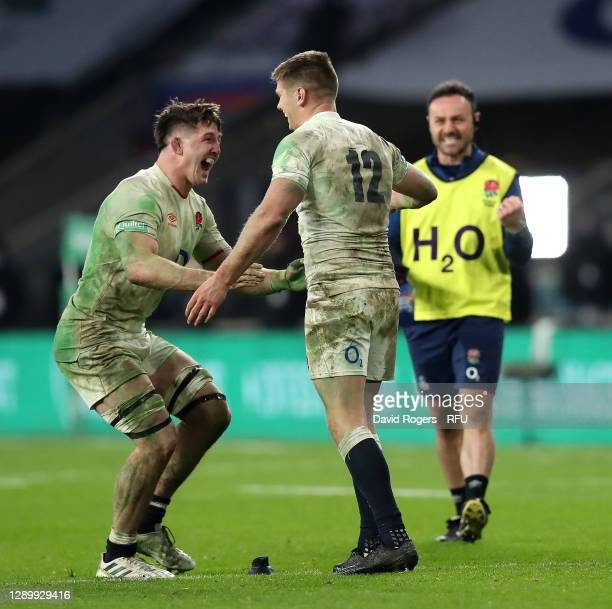 Owen Farrell of England celebrates with team mate Tom Curry after kicking the winning penalty in extra time of the Autumn Nations Cup Final and...