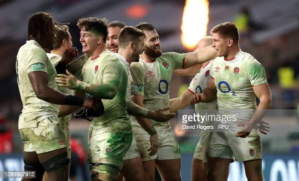 Owen Farrell of England celebrates with team mates after kicking the winning penalty in extra time of the Autumn Nations Cup Final and Quilter...