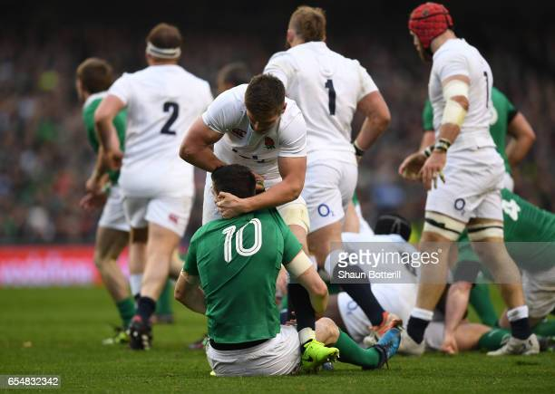 Owen Farrell of England clashes with Jonathan Sexton of Ireland during the RBS Six Nations match between Ireland and England at the Aviva Stadium on...