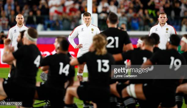 Owen Farrell of England faces the Haka before the Rugby World Cup 2019 Semi-Final match between England and New Zealand at International Stadium...