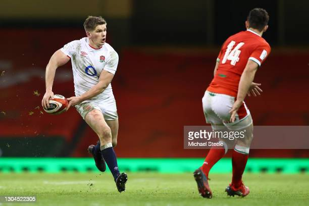 Owen Farrell of England feeds a pass as Louis Rees-Zammit of Wales closes in during the Guinness Six Nations match between Wales and England at...