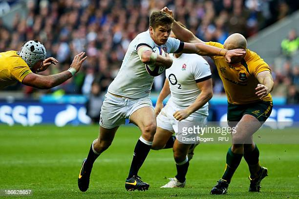 Owen Farrell of England goes past Stephen Moore of Australia to score his team'ssecond try during the QBE International match between England and...