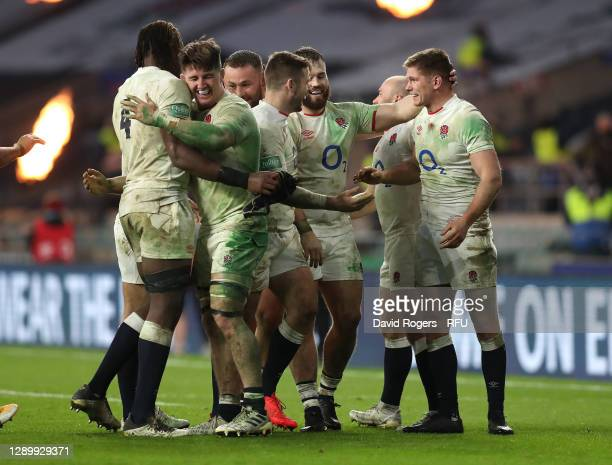 Owen Farrell of England is congratulated by team mates after kicking the winning penalty in extra time of the Autumn Nations Cup Final and Quilter...
