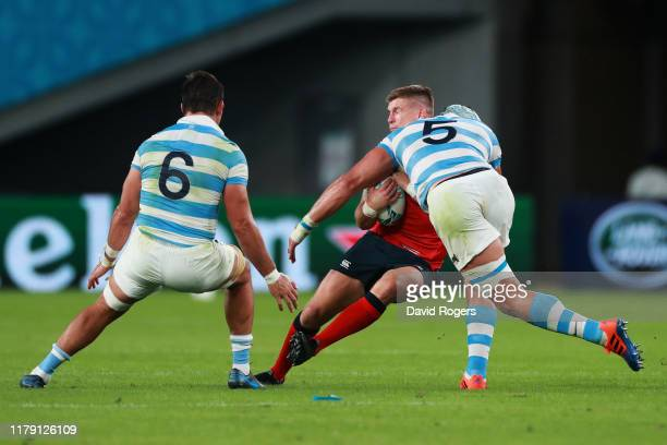 Owen Farrell of England is high tackled by Tomas Lavanini of Argentina resulting in the red card to Tomas Lavanini during the Rugby World Cup 2019...