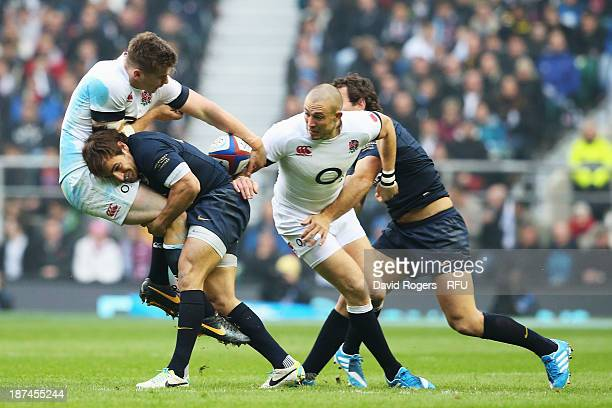 Owen Farrell of England is tackled by Nicolas Sanchez of Argentina during the QBE International match between England and Argentina at Twickenham...