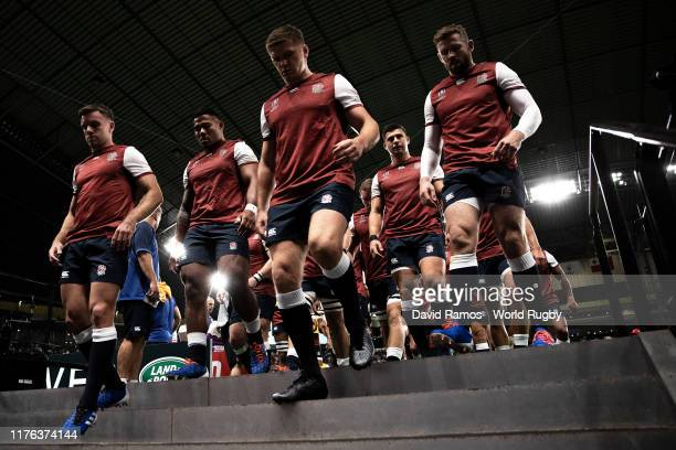 Owen Farrell of England leads the team off the pitch after the warm up prior to the Rugby World Cup 2019 Group C game between England and Tonga at...
