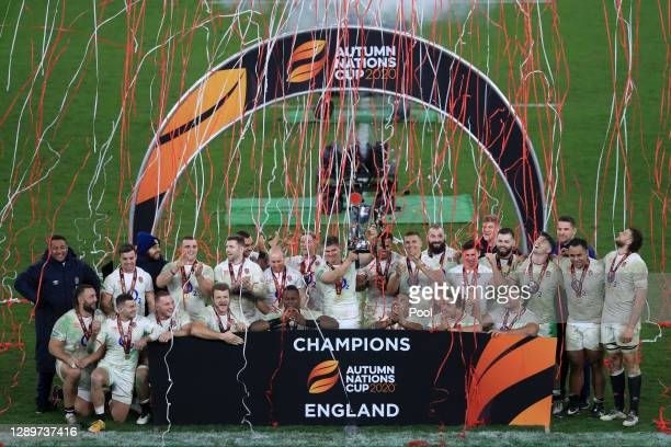 Owen Farrell of England lifts the Autumn Nations Cup with teammates after victory in the Autumn Nations Cup Final & Quilter International between...