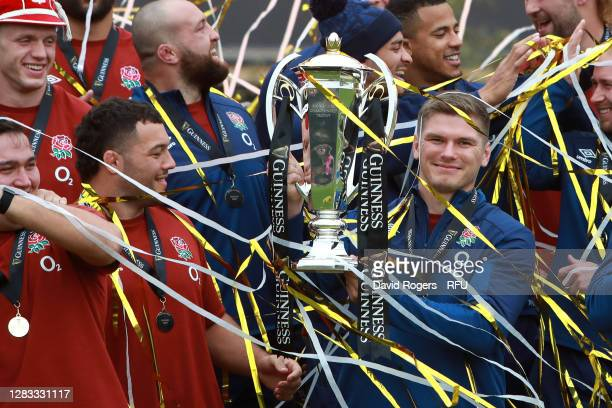 Owen Farrell of England lifts the Guinness Six Nations Trophy as England celebrate winning the Guinness Six Nations during a presentation at The...