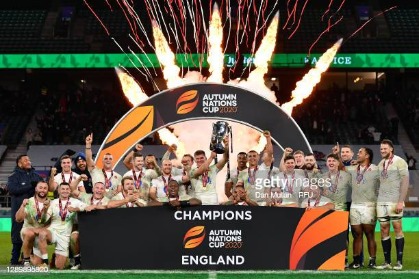 Owen Farrell of England lifts the trophy and celebrates with his team mates following his side's victory during the Autumn Nations Cup Final &...