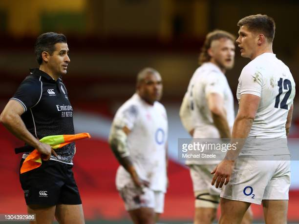 Owen Farrell of England looks to Linesman, Frank Murphy during the Guinness Six Nations match between Wales and England at Principality Stadium on...
