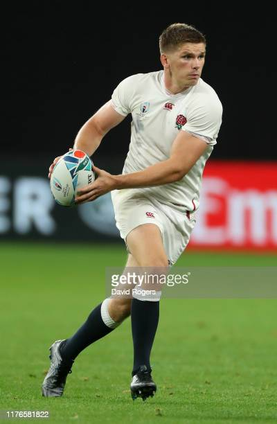 Owen Farrell of England runs with the ball during the Rugby World Cup 2019 Group C game between England and Tonga at Sapporo Dome on September 22...