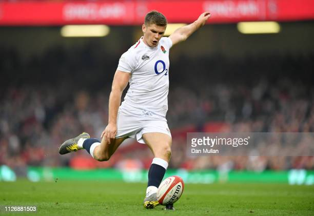 Owen Farrell of England scores from the conversion after the first try during the Guinness Six Nations match between Wales and England at...