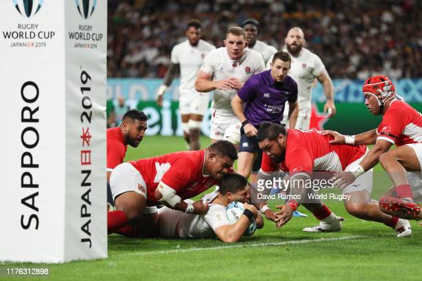 Owen Farrell of England scores his side's third try during the Rugby World Cup 2019 Group C game between England and Tonga at Sapporo Dome on...