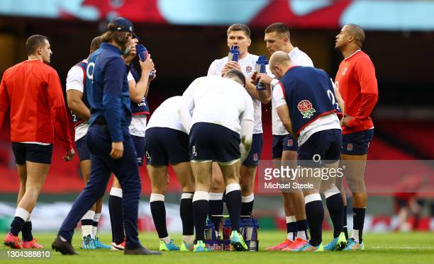 Owen Farrell of England takes a drink during the warm up prior to the Guinness Six Nations match between Wales and England at Principality Stadium on...