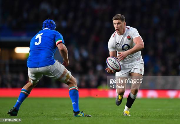 Owen Farrell of England takes on Dean Budd of Italy during the Guinness Six Nations match between England and Italy at Twickenham Stadium on March 9...