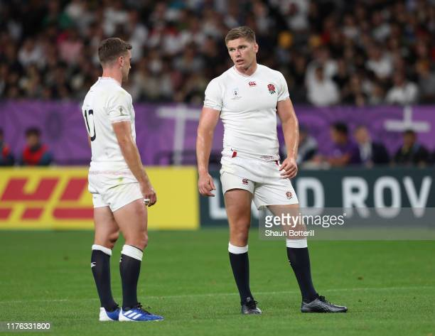 Owen Farrell of England talks with teammate George Ford during the Rugby World Cup 2019 Group C game between England and Tonga at Sapporo Dome on...