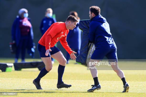 Owen Farrell of England trains on a tackle bag during the England training session ahead of the Guinness Six Nations match between Ireland and...