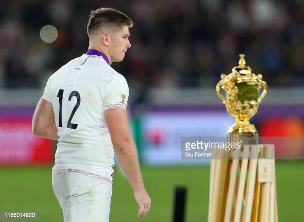 Owen Farrell of England walks past the Web Ellis cup as he collects his runners-up medal after defeat in the Rugby World Cup 2019 Final between...