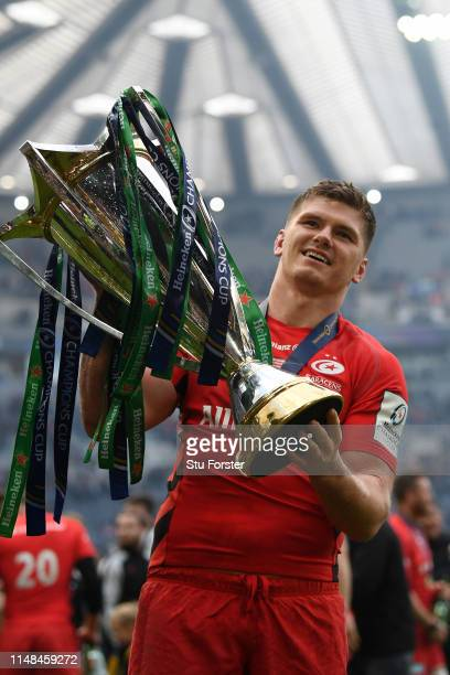 Owen Farrell of Saracens carries the Champions Cup trophy following the Champions Cup Final match between Saracens and Leinster at St. James Park on...