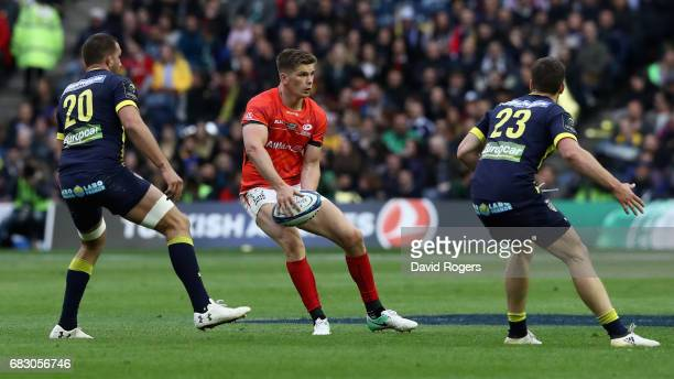 Owen Farrell of Saracens looks to pass the ball during the European Rugby Champions Cup Final between ASM Clermont Auvergen and Saracens at...