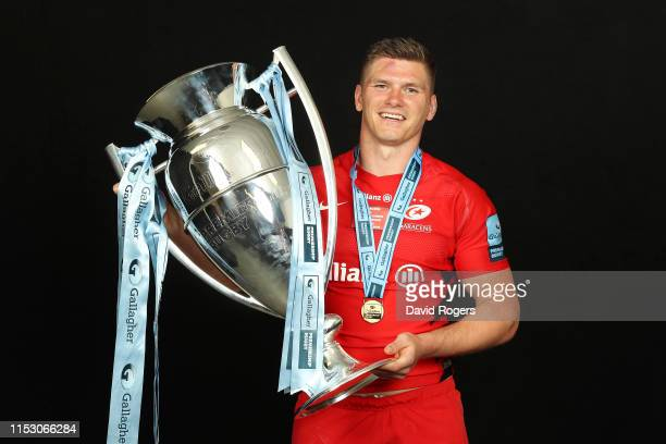 Owen Farrell of Saracens poses for a photograph with the trophy following the Gallagher Premiership Rugby Final between Exeter Chiefs and Saracens at...