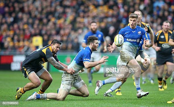 Owen Farrell of Saracens receives the pass for team mate Duncan Taylor to score their second try during the Aviva Premiership match between Wasps and...