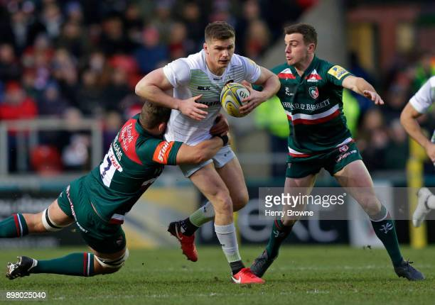 Owen Farrell of Saracens tackled by Mike Williams and George Ford of Leicester Tigers during the Aviva Premiership match between Leicester Tigers and...
