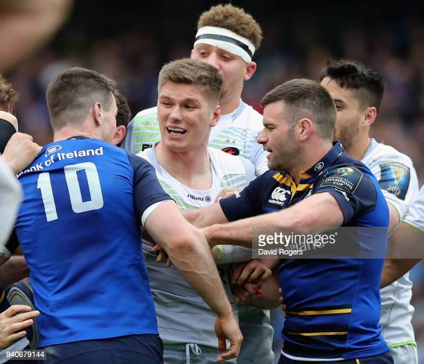 Owen Farrell of Saracens tustles with his opposite number Jonathan Sexton during the European Rugby Champions Cup quarter final match between...