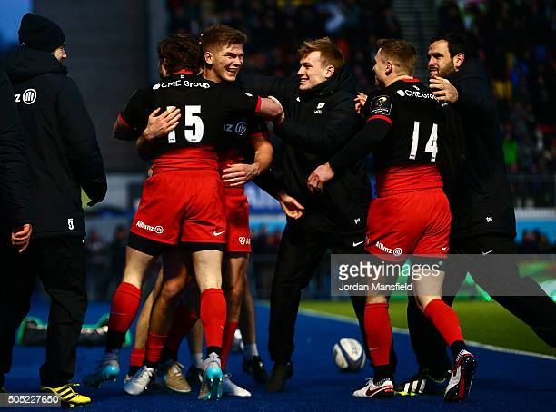 Owen Farrell of Sarcens celebrates with his teammates after Duncan Taylor scores a try during the European Rugby Champions Cup match between Saracens...