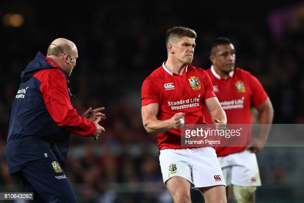 Owen Farrell of the Lions celebrates after kicking a long range penalty to level the scores at 1212 during the third test match between the New...