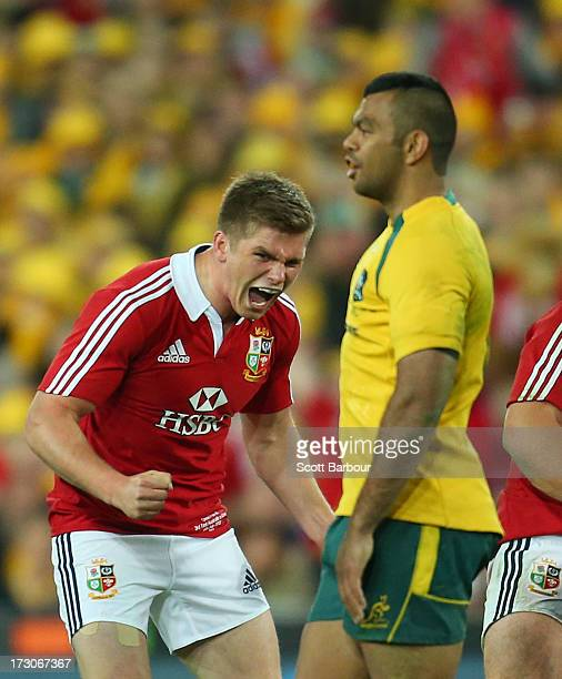 Owen Farrell of the Lions celebrates as Kurtley Beale of the Wallabies looks dejected at the final whistle during the International Test match...