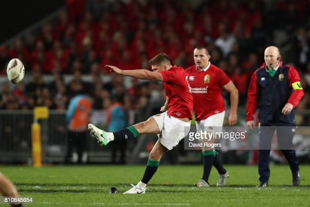 Owen Farrell of the Lions kicks a long range penalty to level the scores at 1515 during the third test match between the New Zealand All Blacks and...
