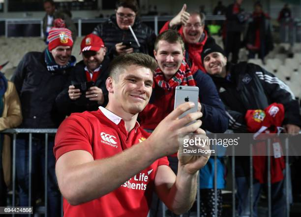 Owen Farrell of the Lions poses for a photo with Lions fans following their team's 123 victory during the 2017 British Irish Lions tour match between...