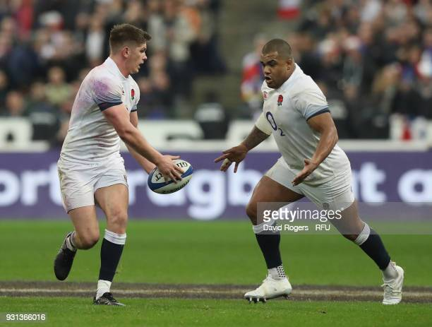 Owen Farrell off loads the ball to Kyle Sinckler during the NatWest Six Nations match between France and England at Stade de France on March 10 2018...
