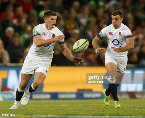 Owen Farrell passes the ball as George Ford adds support during the second test match between South Africa and England at Toyota Stadium on June 16...