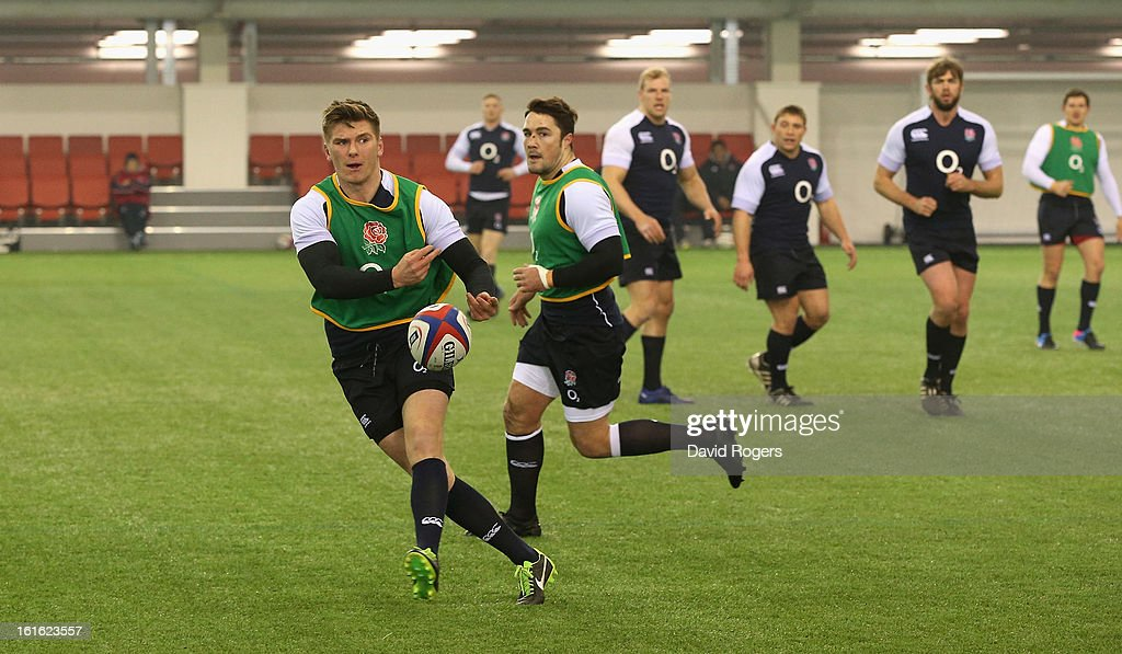Owen Farrell passes the ball during the England training session held at St Georges Park on February 13, 2013 in Burton-upon-Trent, England.